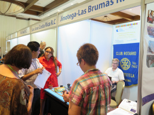 Exhibitors discussion their club projects with international Rotarian visitors